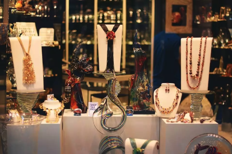 Retail display of jewellery standing on custom props.