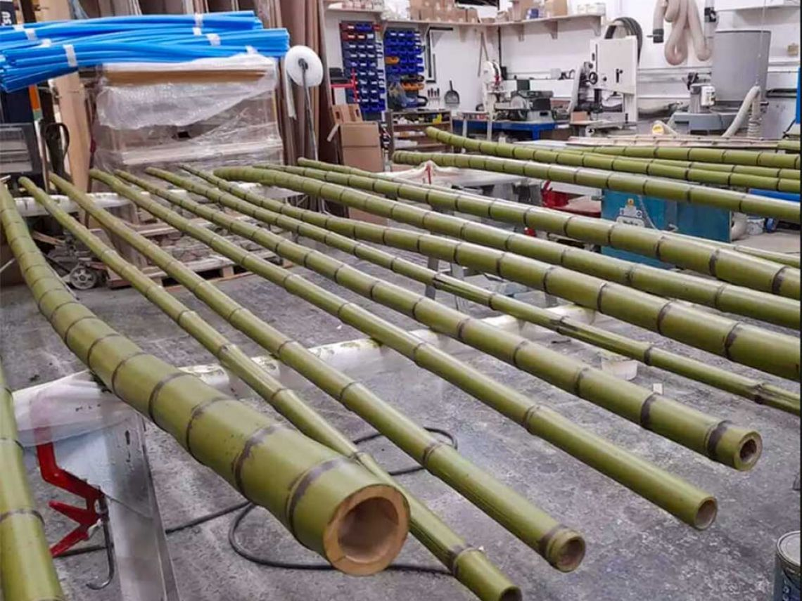 Just a few of the bamboo poles spread out ready for varnish.