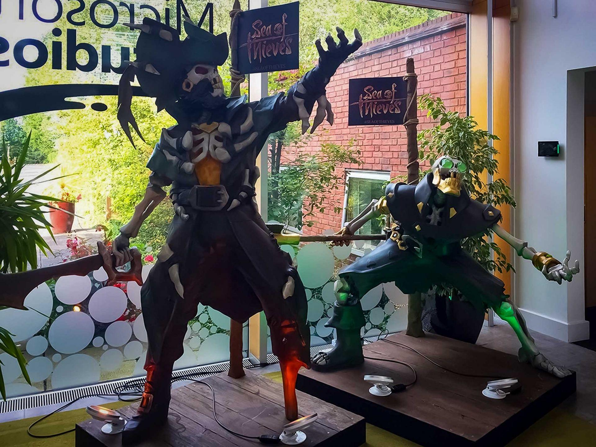 Sea of thieves character props on display at microsoft studios.