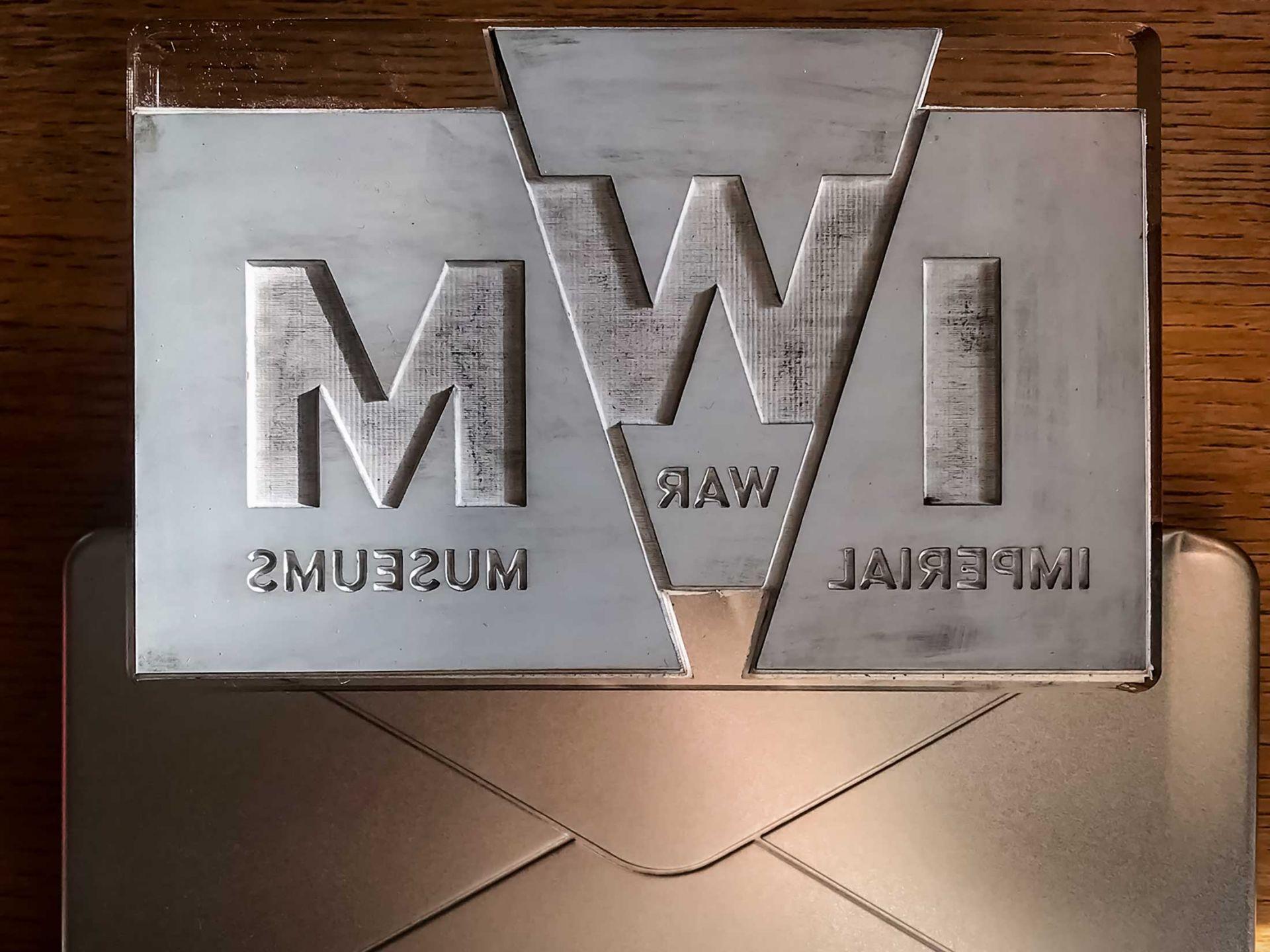 Imperial war museum metal embossed logo with metal envelope tin.