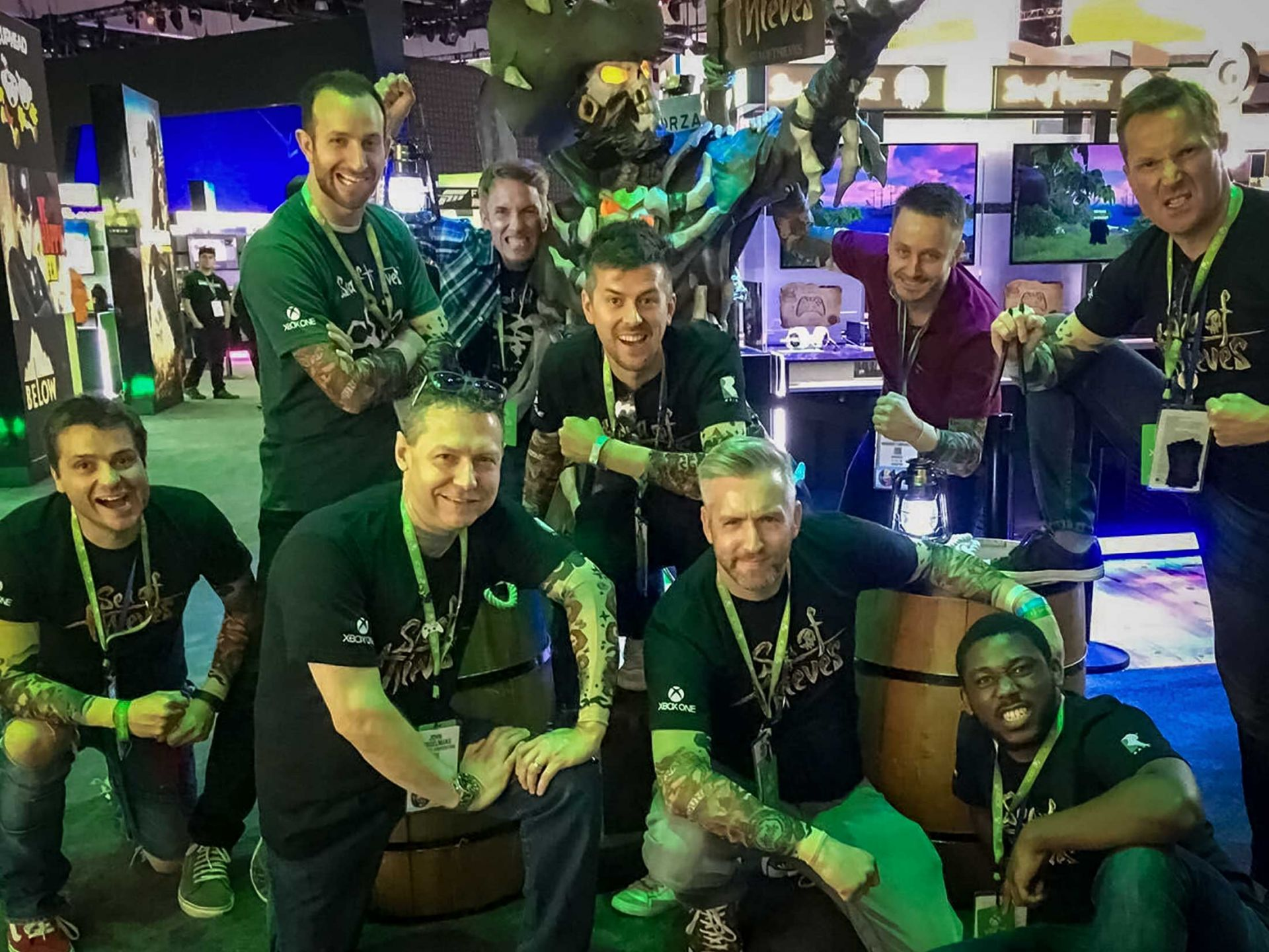 Microsoft team with sea of thieves prop at e3 expo.