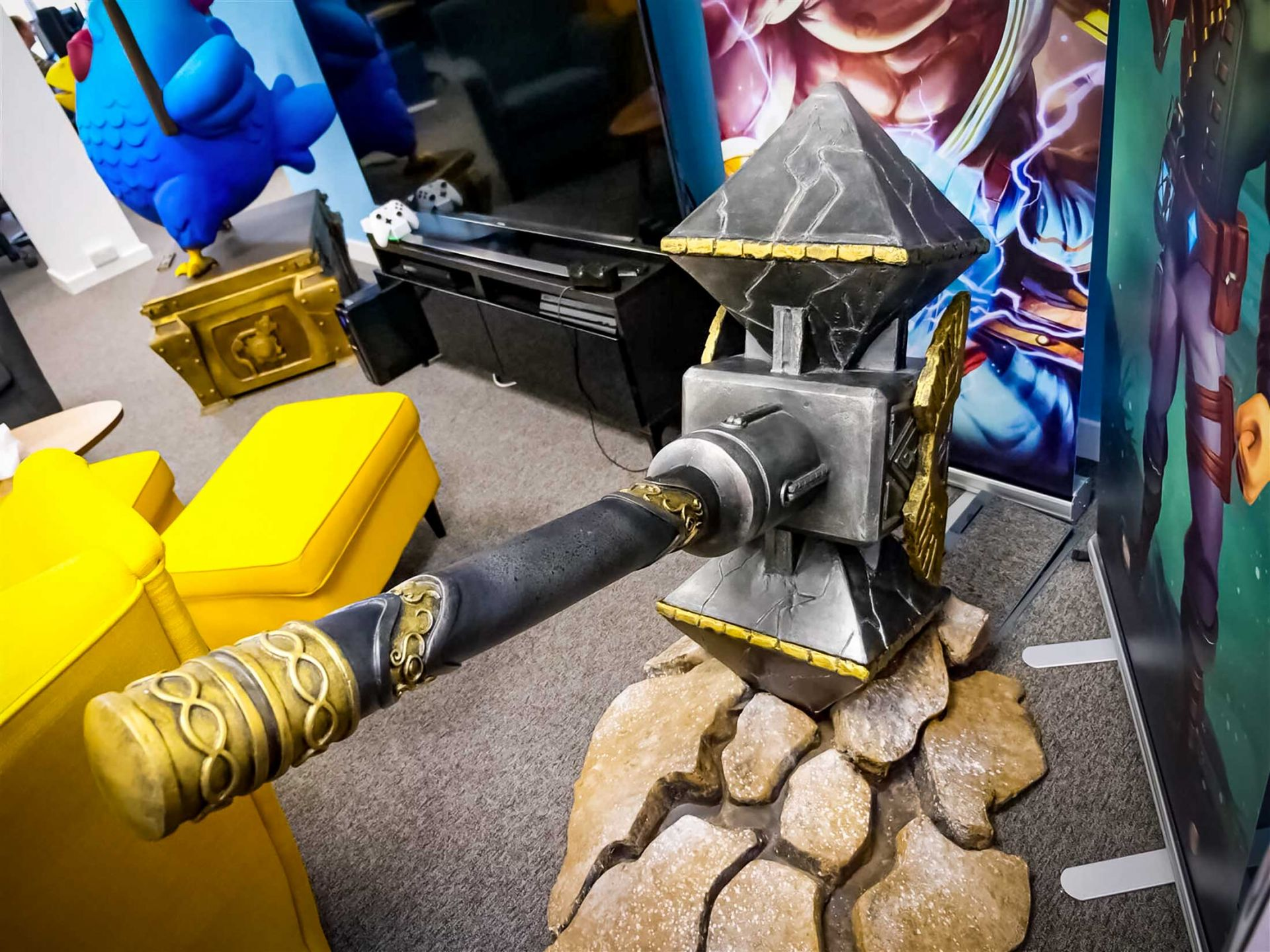 Giant Thor hammer prop in a gaming room on display.