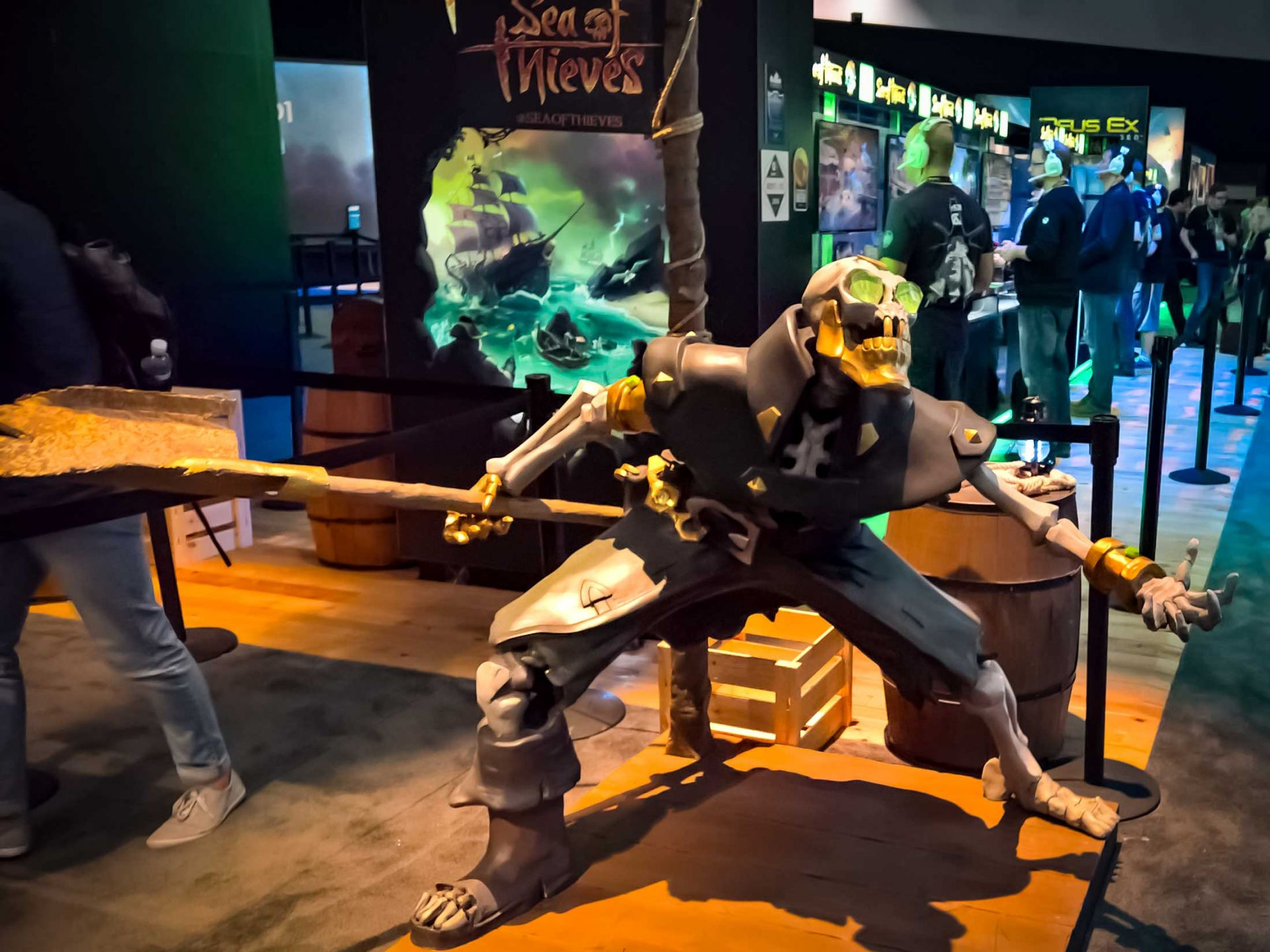 Sea of thieves character at the e3 expo on display with green glowing eyes.