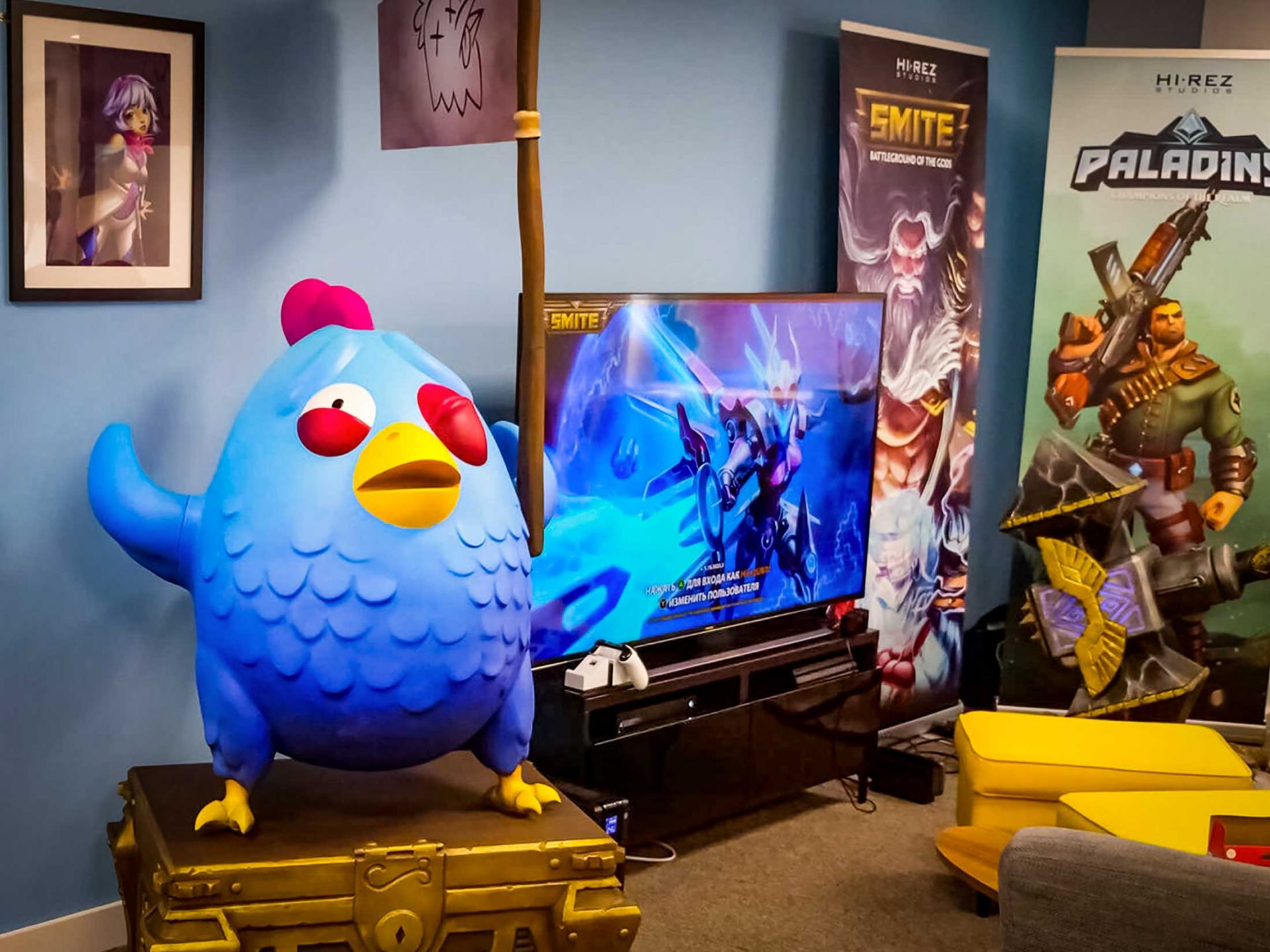Chicken and hammer props on display in a games room.
