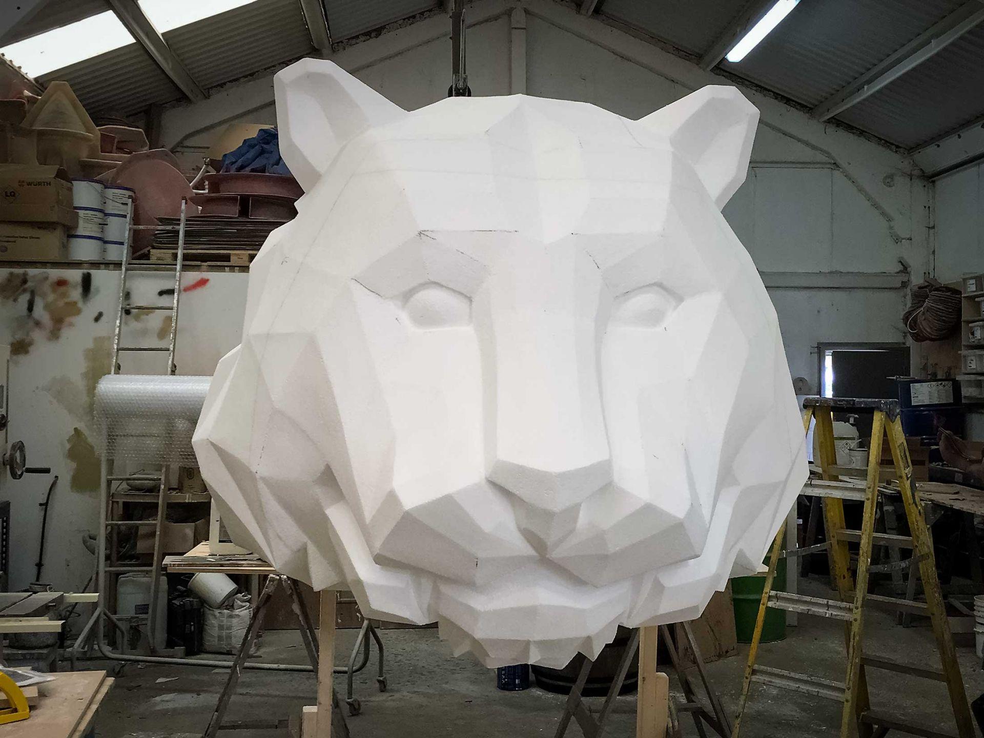Giant polystyrene carved tiger in workshop.