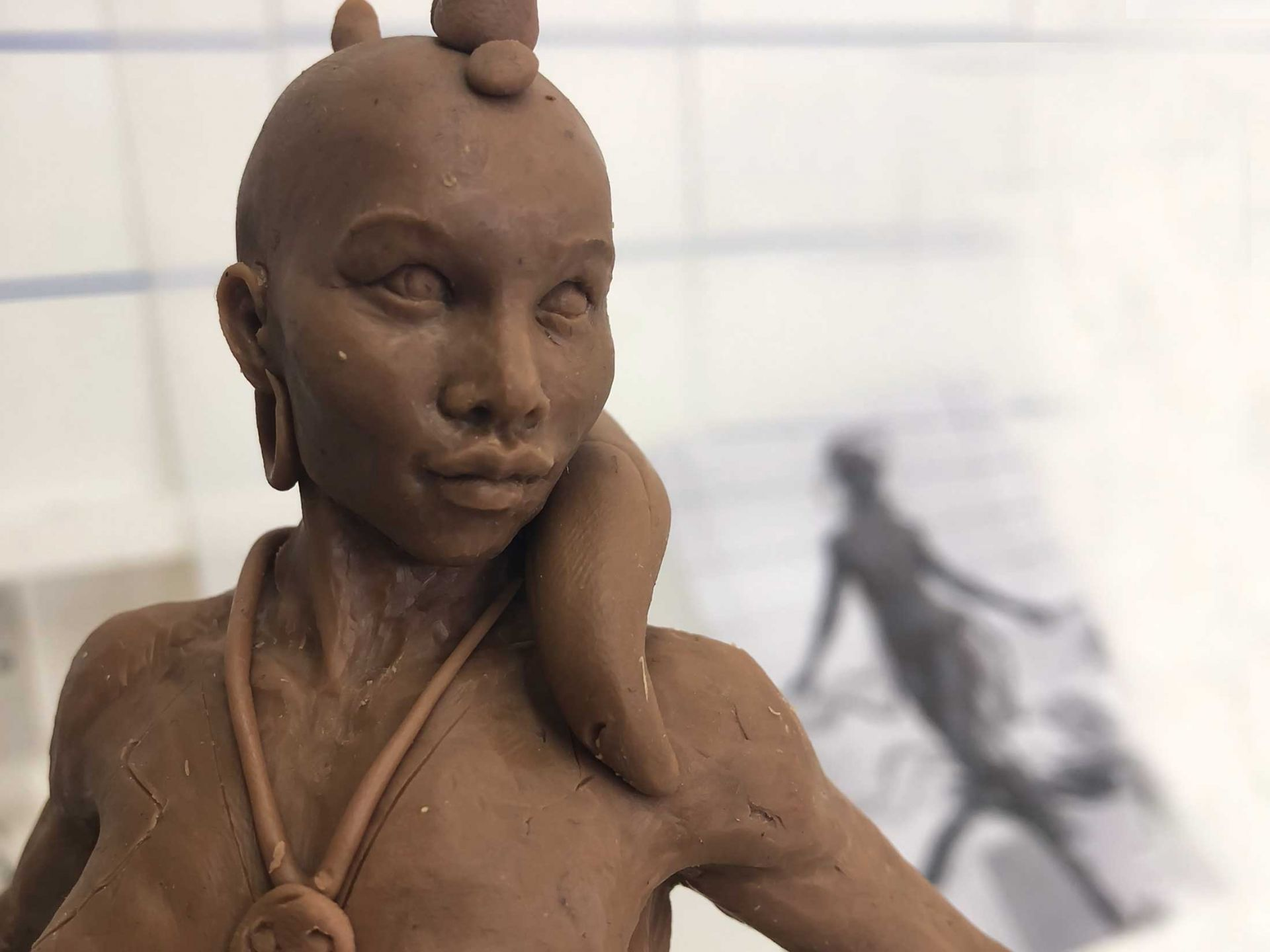 Spur girl sculpture made from clay.